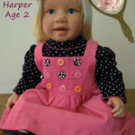 Doll that Looks Like Your Child wearing pink jumper