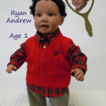 Doll That Looks Like Your Child dressed in red vest