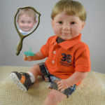 Photo Doll Boy Wearing Orange Polo Shirt