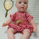 Doll That Looks Like Your Child Wearing Red Check Romper