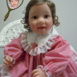 Doll That Looks Like Your Child Wearing Rose Dress