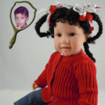 Doll That Looks Like Your Child Wearing Red Sweater