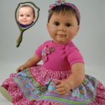 Doll That Looks Like Your Child Dressed in Bright Pink