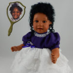 Doll That Looks Like Your Child Wearing White Lace with Purple