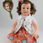 Photo doll of two year old Adaline with curly hair